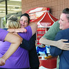 BRYAN EATON/ Staff Photo. Workers and customers of the Market Basket in Newburyport embrace as the company headed toward normal operations again after the pending sale to Arthur T. Demoulas.