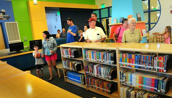 BRYAN EATON/ Staff Photo. Newburyport residents check out the library at the new Bresnahan School during an open house last night.