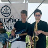 JIM VAIKNORAS/Staff photo Joe Holaday, center and his sons, Jared on Sax and PJ on drums perform at the Newburyport 250th Clam Bake at Plum Island point Sunday afternoon.