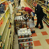 BRYAN EATON/ Staff Photo. Workers at the Market Basket at Southgate Plaza in Seabrook got a truckload of food dropped off Thursday morning and didn't waste time trying to fill the shelves.
