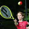 BRYAN EATON/Staff Photo. Frankie Sullivan, 9, has her eye on the tennis ball at Atkinson Common on Wednesday morning. She was in the Newburyport Youth Services tennis camp.