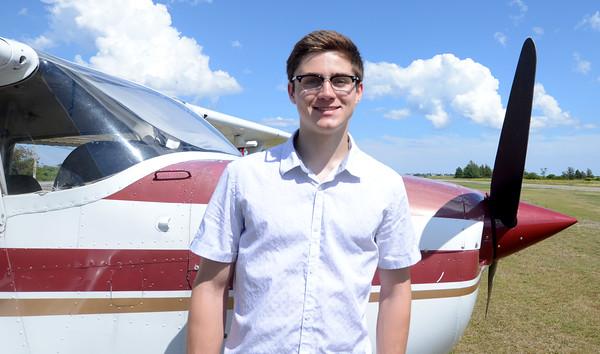 JIM VAIKNORAS/Staff photo 18 year old pilot Luke... at the Plum Island Airport.
