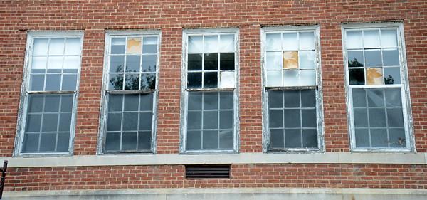 JIM VAIKNORAS/Staff photo  Broken windows at the Brown School building in Newburyport.