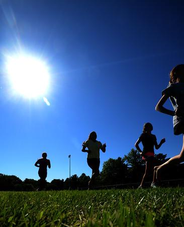 JIM VAIKNORAS/Staff photo <br /> Triton Cross Country team running at Triton's football field.