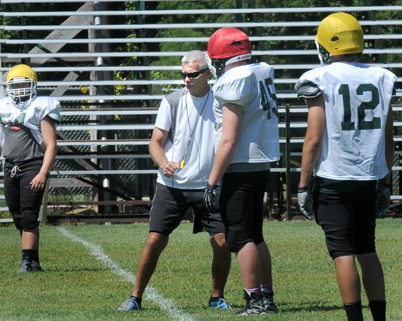 BRYAN EATON/Staff Photo. Pentucket High head football coach Steve Hayden works with the offense.