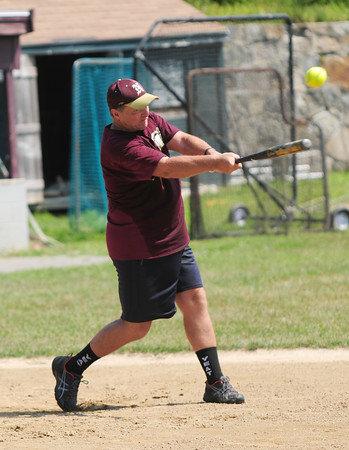 JIM VAIKNORAS/Staff photo  Steve Malenfant class of 72 take a big cut at a pitch during the annual Newburyport Baseball Alunmi Association softball game at Pettingell Field in Newburyport Saturday.