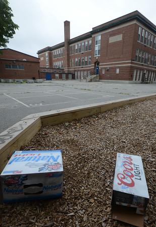 JIM VAIKNORAS/Staff photo  Tow empty beer cartons at the Brown School building in Newburyport.