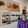 BRYAN EATON/Staff photo. Mary Pollack, left, and sister Wendy Mathias stand near a photo display at the Custom House Maritime Museum. The photos were taken by their father Fred Slade, Jr. of Greenland while he was in the U.S. Coast Guard during the 1940's.