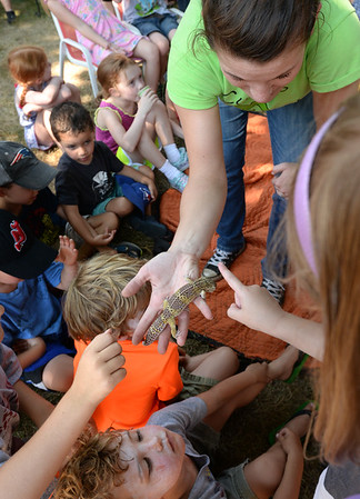BRYAN EATON/Staff photo. Sarah Soucy of Curious Creatures shows off a leopard gecko at the Emma Andrews Library in Newburyport on Thursday afternoon. It was the last day of their free summer programs for kids.