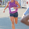 JIM VAIKNORAS/Staff photo Jessica Bailey woman's winner of the Yankee Homecoming 5k road race Tuesday night.