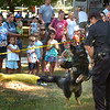 BRYAN EATON/Staff photo. Newburyport police canine officer Eric Marshall introduces his dog Epic at Kids Day in the Park.