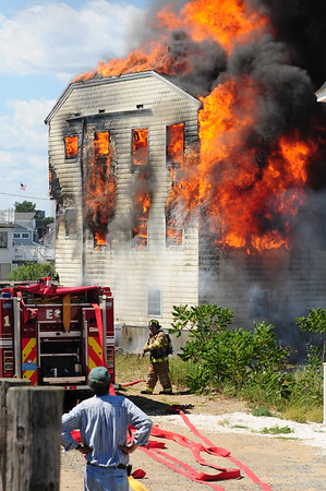JIM VAIKNORAS/Staff photo Flames engulf a home on 20th Street on Plum Island Saturday.
