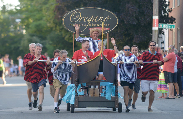 JIM VAIKNORAS/Staff photo. Oregano's Pizza on a gondola bed makes it's down Federal Street in the annual Lions Club Bed Race.
