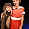 BRYAN EATON/Staff photo. Annie, played by Ella Comparato, 11, right, with Ava Valianti, 7, as Sandy.
