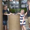 JIM VAIKNORAS/Staff photo<br />  Taetum Kotter, 4, plashes her brothers Mickey, 10, on right and Haden, 6, at the fountain on Inn Street in Newburyport Sunday afternoon. With temperatures in the 90's it's unlikely either of them minded getting wet.