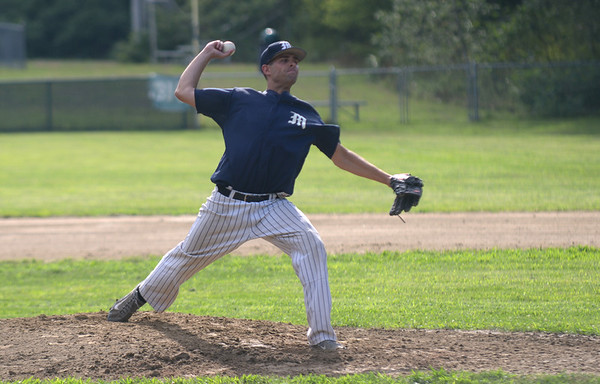 JIM VAIKNORAS/Staff photo  Manchester pitcher Ryan Margues pitches against Rowley at Eiras Field in Rowley