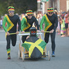 JIM VAIKNORAS/Staff photo.Crossfit rocked Jamacan unitards as they sprint down Federal Street in the annual Lions Club Bed Race.