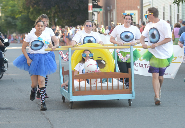JIM VAIKNORAS/Staff photo. All eyes were on Vision Source as they race down Federal Street in the annual Lions Club Bed Race.
