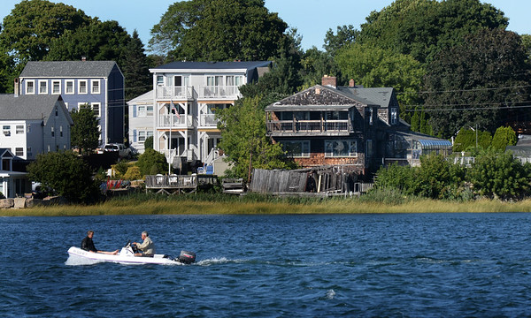 BRYAN EATON/Staff photo. The new owner of this home on the right, at 22 and 24 First Street on Ring's Island, in Salisbury is going to the Zoning Board of Appeals to be razed and two homes built in its place. View is from the Newburyport waterfront.