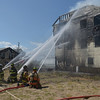 JIM VAIKNORAS/Staff photo Firefighters pours water on a fire on 20th Street on Plum Island.
