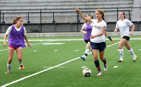 BRYAN EATON/Staff photo. Newburyport High girls soccer team practice at Stehlin Field on Friday.