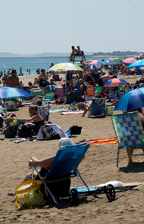 JIM VAIKNORAS/Staff photo Beach chairs and umbrellas cover Salisbury Beach Friday afternoon. With nice weather expected over the the weekend, local beaches should be packed.