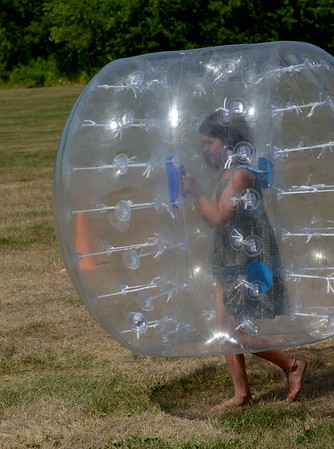 JIM VAIKNORAS/ Staff photo Cali Titcome, 7, is wrapped in plastic during a game of Bubble soccer at Seabrook Old Home Days Saturday at Seabrook Middle School.