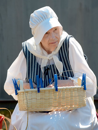 JIM VAIKNORAS/Staff photo Sally Watkins makes baskets at a 18th century reinactors encampment by the Dearborn's Company behind the Custom's House in Newburyport Saturday.
