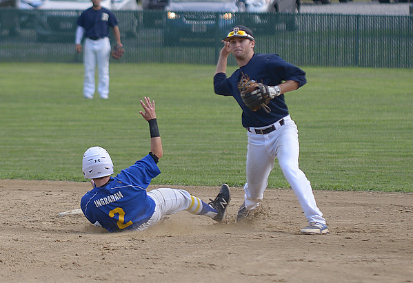 JIM VAIKNORAS/Staff photo Manchester's Cole Josselyn turns a double play as Rowley's CJ Ingraham slides into second at Eiras Field in Rowley.