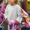 BRYAN EATON/Staff photo. Mia Renaud, 4, of Lewiston, Maine, whose grandparents live in Newburyport, won best bike in the Bike and Doll Carriage Parade in Kids Day in the Park.