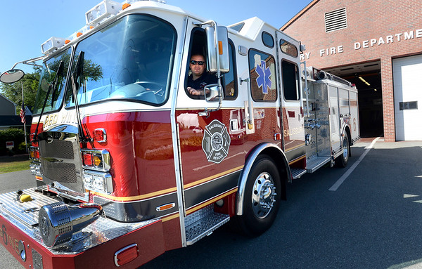 "BRYAN EATON/Staff photo. Salisbury firefighter John Condelli shows off his department's fire engine named ""Red Wing."""