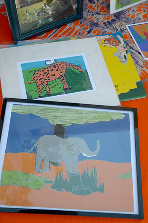 JIM VAIKNORAS/Staff photo Artwork done by children in Africa to bring attention to endangered rhinos and elephants