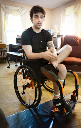 BRYAN EATON/Staff photo. Matthew Klos, 26, talks about the paralysis that hit him with no warning.