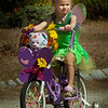 BRYAN EATON/Staff photo. Olivia Clinton, 5, of Woburn, whose family is from Newburyport, won grand prize in the Bike and Doll Carriage Parade at Kids Day in the Park dressed as Tinkerbell.