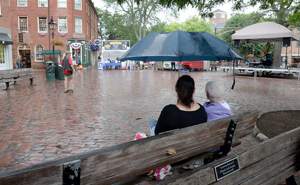 Bryan Eaton/Staff photo. A little rain cleared Market Square yesterday in the afternoon, but the crowds returned afterward, and the weather improves as the week goes on.
