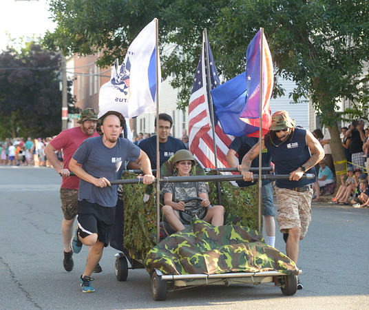 JIM VAIKNORAS/Staff photo.East Coast Welding honored the armed forces as they raced down Federal Street in the annual Lions Club Bed Race.