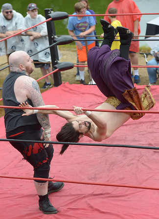 """JIM VAIKNORAS/Staff photo Atlantic Pro Wrestler Evan Siks thrills the crowd as he tosses The """"Sheik"""" Abdullah Hassan during their match Old Fashioned Sunday at teh Bartlet Mall."""