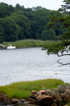 JIM VAIKNORAS/Staff photo A woman on Deer Island in Amesbury enjoys the cool weather Saturday afternoon.