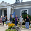 JIM VAIKNORAS/Staff photo Residence build a human chain around the Rowley Library to give it a hug as they celebrate it's 125 birthday Saturday.