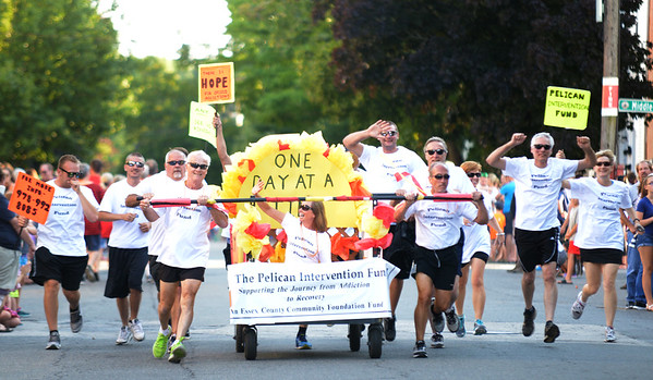 JIM VAIKNORAS/Staff photo. The Pelican Intervention Fund bed makes it's down Federal Street in the annual Lions Club Bed Race.
