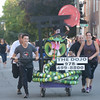 JIM VAIKNORAS/Staff photo. Tokyo Joes bed makes it's down Federal Street in the annual Lions Club Bed Race.