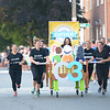JIM VAIKNORAS/Staff photo. The Community Connection's bed makes it's down Federal Street in the annual Lions Club Bed Race.