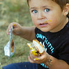 BRYAN EATON/Staff photo. Sean Acosta, 2, of Haverhill did get some cheesesburger and mustard into his mouth at Kids Day in the Park.