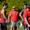 BRYAN EATON/Staff photo. Amesbury High School football coach Glen Gearin gets his team going for the season.