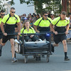 JIM VAIKNORAS/Staff photo. THE Newburyport Police sprint to the finish  in the annual Lions Club Bed Race on Federal Street.