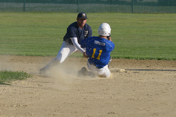 JIM VAIKNORAS/ Staff photo Manchester's Caulin Rogers tags out Joe Esposito on a steal attempt during their championship game at Erias Field in Rowley. Manchester won the game 3-2.