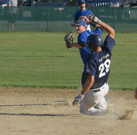JIM VAIKNORAS/ Staff photo Rowley's CJ Ingraham turns a double play as Manchester's Rusty Tucker slide into 2nd during their championship game at Erias Field in Rowley. Manchester won the game 3-2.