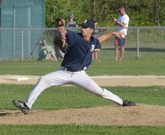 JIM VAIKNORAS/ Staff photo Manchester's Rusty Tucker pitches against Rowley during their championship game at Erias Field in Rowley. Manchester won the game 3-2.