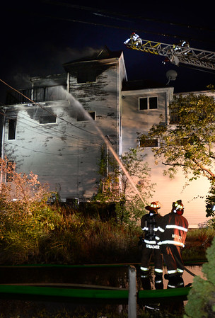 BRYAN EATON/Staff photo. Firefighters from Newburyport and surrounding communities responded to a fire on 61st Street in the Newburyport section of Plum Island on Sunday night. The three-story home appeared to be two family as two electric meters were visible.