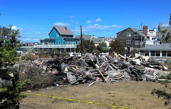 JIM SULLIVAN/Staff photo. The view of the former 11 20th St. home on Plum Island, which was totaled by fire Saturday, taken from Hubert Mulligan's back porch.